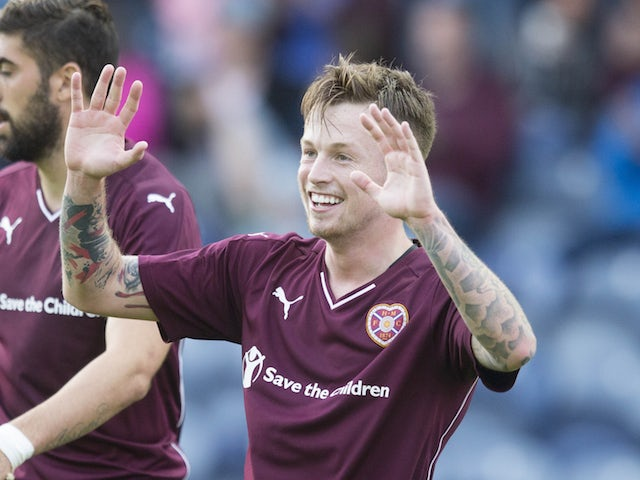 Gary Oliver of Hearts celebrates during the Pre Season Friendly between Raith Rovers and Hearts at Starks Park on July 07, 2015 in Kirkcaldy, Scotland. (Photo by Jeff Holmes/Getty Images)