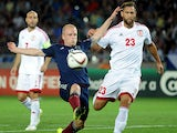 Steven Naismith (L) of Scotland vie for a ball with Levan Mchedlidze (R) of Georgia during their Euro 2016 qualifying football match between Georgia and Scotland in Tbilisi on September 4, 2015