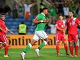 Ireland's defender Cyrus Christie (C) celebrates after scoring the opening goal during the Euro 2016 qualifying football match Gibraltar vs Republic of Ireland at the Algarve stadium in Faro on September 4, 2015.