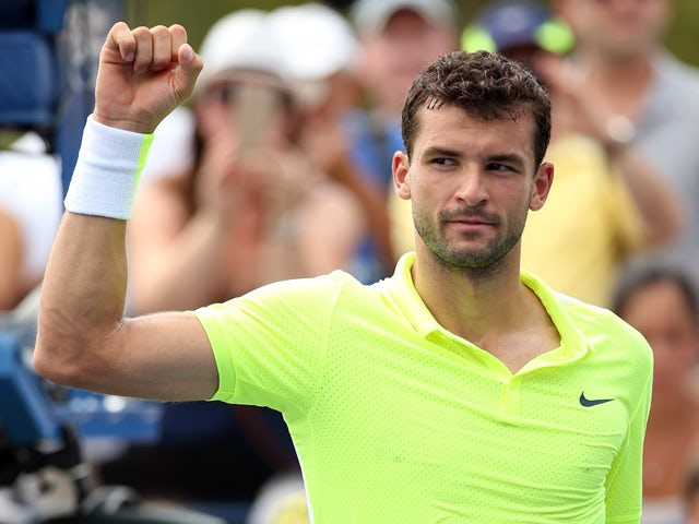 Grigor Dimitrov of Bulgaria reacts after defeating Matthew Ebden of Australia during their Men's Singles First Round match on Day One of the 2015 US Open at the USTA Billie Jean King National Tennis Center on August 31, 2015