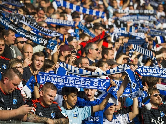HSV fans sing during the German First division Bundesliga football match Hamburger SV vs TSG 1899 Hoffenheim on October 19, 2014 in Hamburg, northern Germany. AFP PHOTO / ODD ANDERSEN