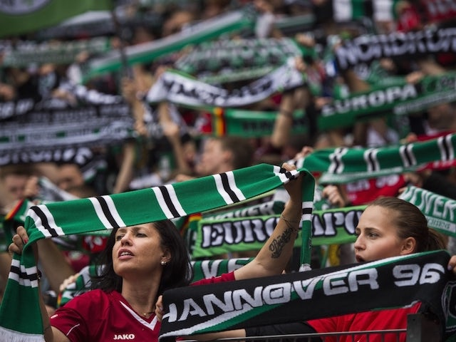 Hannover fans watch during German first division Bundesliga football match Hannover 96 vs SC Freiburg at the HDI-Arena in Hanover, northern Germany on May 23, 2015. AFP PHOTO / ODD ANDERSEN