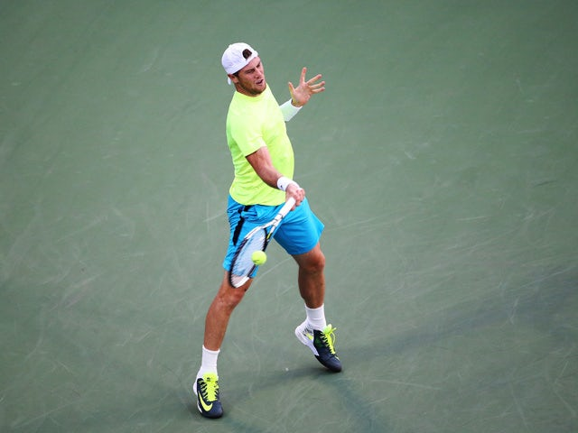 Illya Marchenko of Ukraine returns a shot against Gael Monfils of France during their Men's Singles First Round match on Day One of the 2015 US Open at the USTA Billie Jean King National Tennis Center on August 31, 2015