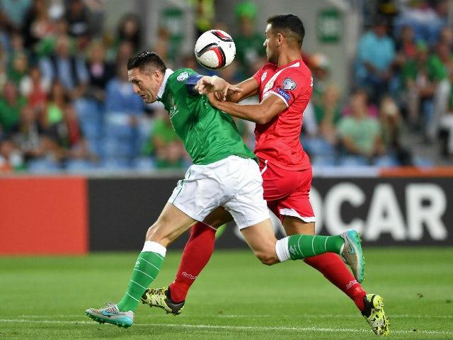 Ireland's forward Robbie Keane (L) vies with Gibraltar's defender Joseph Chipolina during the Euro 2016 qualifying football match Gibraltar vs Republic of Ireland at the Algarve stadium in Faro on September 4, 2015.