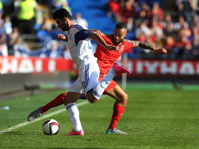 Wales's defender Ashley Richards (R) vies with Israel's defender Omri Ben Harush during the Euro 2016 qualifying group B football match between Wales and Israel at Cardiff City Stadium in Cardiff, south Wales, on September 6, 2015