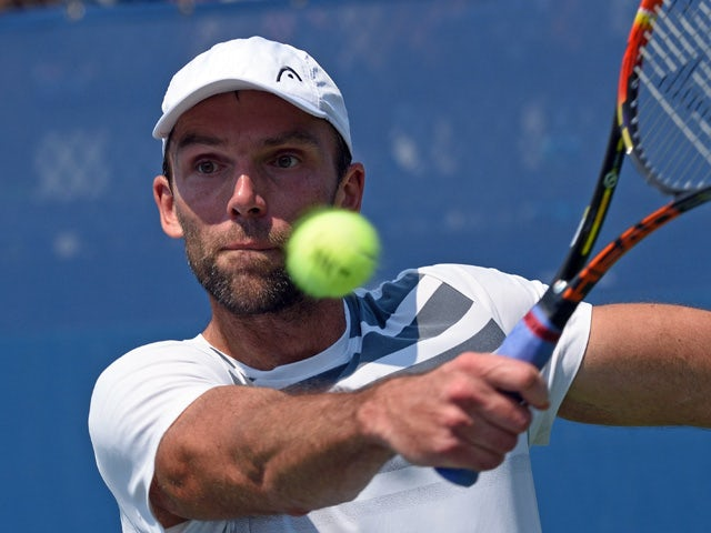 Ivo Karlovic of Croatia hits a return to Federico Delbonis of Argentia during their US Open 2015 first round men's singles match at the USTA Billie Jean King National Center September 1, 2015