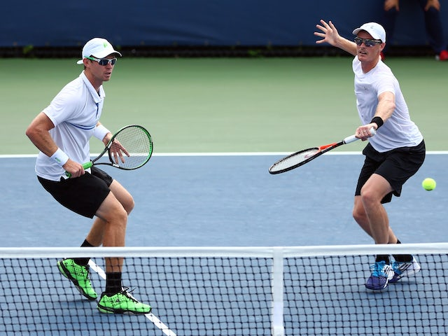 Jamie Murray of Great Britain and John Peers of Australia return a shot to Bjorn Fratangelo and Dennis Novikov of the USA during their Men's Doubles First Round Match on Day Three of the 2015 US Open at the USTA Billie Jean King National Tennis Center on
