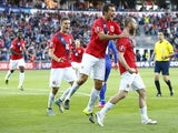 Norway's Jo Inge Berget (R) celebrates scoring 1 - 0 with his teammates Markus Henriksen (L) and Even Hovland during the Euro 2016 Group H qualifying football match between Norway and Croatia at in Oslo, on September 6, 2015.