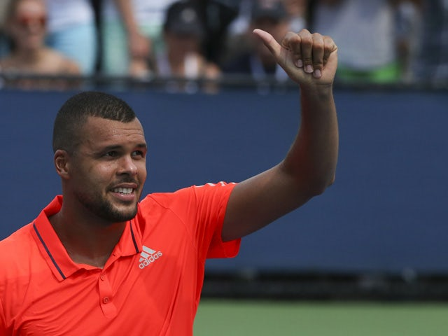Jo-Wilfried Tsonga of France celebrates after defeating Jarkko Nieminen of Finland during their 2015 US Open Men's Singles round 1 match at the USTA Billie Jean King National Tennis Center August 31, 2015