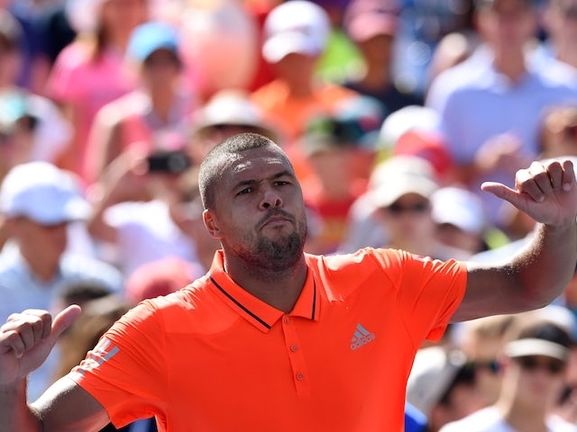 Jo-Wilfried Tsonga of France celebrates after defeating his compatriot Benoit Paire during their 2015 US Open Men's singles round 4 match at USTA Billie Jean King National Tennis Center in New York on September 6, 2015. Tsonga won 6-4, 6-3, 6-4.