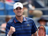 John Isner of the United States reacts after defeating Malek Jaziri of Tunisia during their Men's Singles First Round match on Day Two of the 2015 US Open at the USTA Billie Jean King National Tennis Center on September 1, 2015