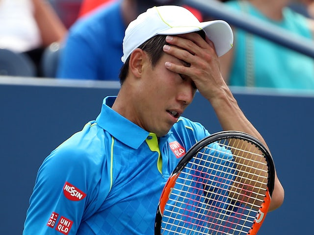 Kei Nishikori of Japan reacts against Benoit Paire of France during their Men's Single First Round match on Day One of the 2015 US Open at the USTA Billie Jean King National Tennis Center on August 31, 2015