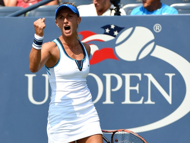 Lesia Tsurenko of Ukraine scores a match point against Lucie Safarova of the Czech Republic during their 2015 US Open Women's singles round 1 match at the USTA Billie Jean King National Tennis Center September 1, 2015