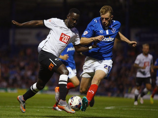 Matt Clarke of Portsmouth tries to tackle Simon Dawkins of Derby County during the Capital One Cup First Round match between Portsmouth v Derby County at Fratton Park on August 12, 2015 in Portsmouth, England. (Photo by Ian Walton/Getty Images)
