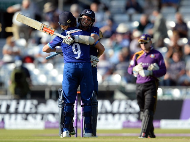 Michael Klinger (C) and Hamish Marshall of Gloucestershire react after hitting the winning runs during the Royal London One-Day Cup Semi Final between Yorkshire Vikings and Gloucestershire at Headingley on September 6, 2015