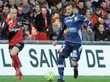 Guingamp's French forward Thibault Giresse (L) vies with Evian's midfielder Milos Ninkovic during the French L1 football match between Guingamp and Evian on April 18, 2015 at the Roudourou stadium in Guingamp, western of France.