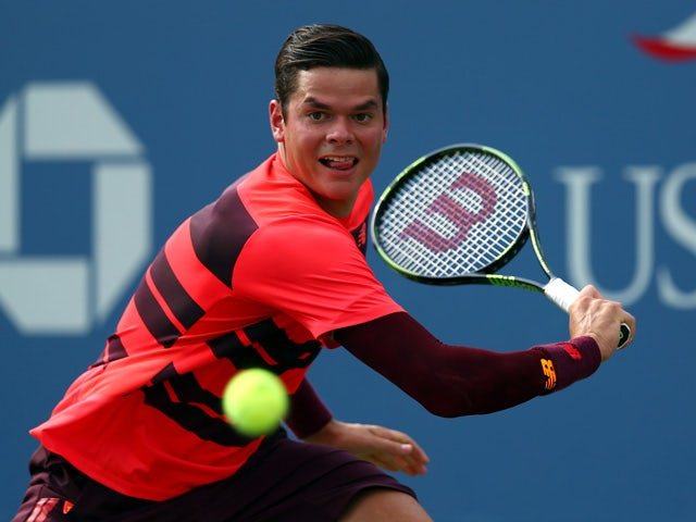 Milos Raonic return a shot against Tim Smyczek of the United States during their Men's Singles First Round match on Day One of the 2015 US Open at the USTA Billie Jean King National Tennis Center on August 31, 2015