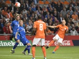 Netherlands' Arjen Robben (R) shoots the ball during the Euro 2016 qualifying round football match between Netherlands and Iceland at the Arena Stadium, on September 3, 2015