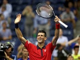 Novak Djokovic of Serbia celebrates his win over Andreas Haider-Maurer of Austria during their Men's Singles Second Round match on Day Three of the 2015 US Open at the USTA Billie Jean King National Tennis Center on September 2, 2015