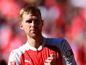 Report: Mertesacker out for five months
