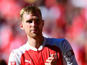 Per Mertesacker of Arsenal celebrates his team's 1-0 win in the FA Community Shield match between Chelsea and Arsenal at Wembley Stadium on August 2, 2015