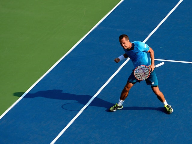 Philipp Kohlschreiber of Germany celebrates after defeating Alexander Zverev of Germany during their Men's Singles First Round match on Day Two of the 2015 US Open at the USTA Billie Jean King National Tennis Center on September 1, 2015 in the Flushing ne