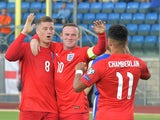 England's midfielder Ross Barkley celebrates with England's forward Wayne Rooney and England's forward Alex Oxlade Chamberlain after scoring during the EURO 2016 qualifying football match San Marino vs England at the San Marino stadium in Serravalle on Se