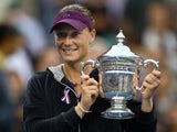 Samantha Stosur of Australia celebrates with the championship trophy after defeating Serena Williams of the United States to win the Women's Singles Final on Day Fourteen of the 2011 US Open at the USTA Billie Jean King National Tennis Center on September