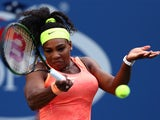 Serena Williams of the United States returns a shot to Madison Keys of the United States during their Women's Singles Fourth Round match on Day Seven of the 2015 US Open