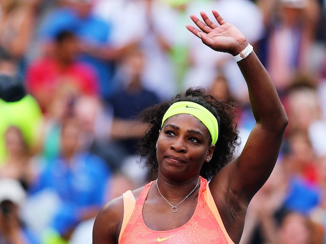 Serena Williams of the United States celebrates after defeating Madison Keys of the United States during their Women's Singles Fourth Round match on Day Seven of the 2015 US Open