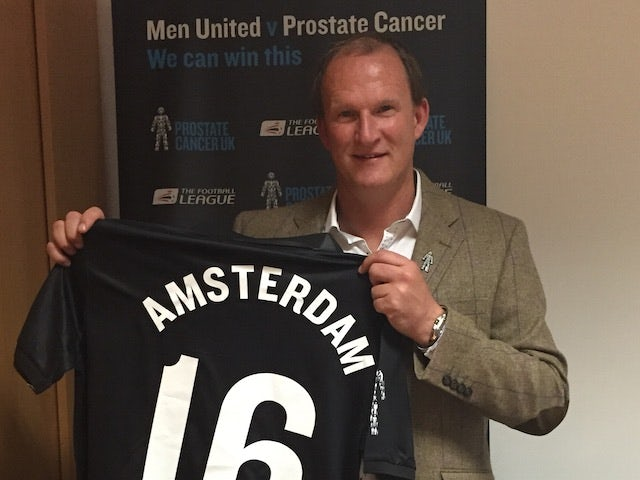 Simon Grayson poses with a Men United shirt to promote the Football to Amsterdam bike ride