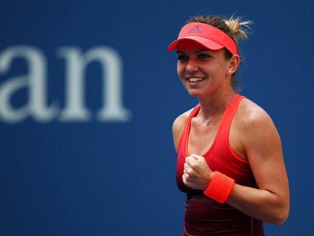 Simona Halep of Romania celebrates defeating Kateryna Bondarenko of the Ukraine during their Women's Singles Second Round match on Day Four of the 2015 US Open at the USTA Billie Jean King National Tennis Center on September 3, 2015