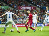 Andres Iniesta of Spain duels for the ball with Peter Pekarik of Slovakia during the Spain v Slovakia EURO 2016 Qualifier at Carlos Tartiere on September 5, 2015 in Oviedo, Spain.