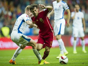 David Silva of Spain duels for the ball with Tomas Hubocan of Slovakia during the Spain v Slovakia EURO 2016 Qualifier at Carlos Tartiere on September 5, 2015 in Oviedo, Spain.