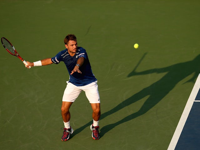 Stan Wawrinka of Switzerland returns a shot against Albert Ramos-Vinolas of Spain during their Men's Singles First Round match on Day Two of the 2015 US Open at the USTA Billie Jean King National Tennis Center on September 1, 2015 in the Flushing neighbor