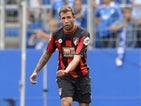 Steve Cook of Bournemouth controls the ball during the friendly match between 1899 Hoffenheim and AFC Bournemouth at Wirsol Rhein-Neckar-Arena on August 1, 2015 in Sinsheim, Germany.