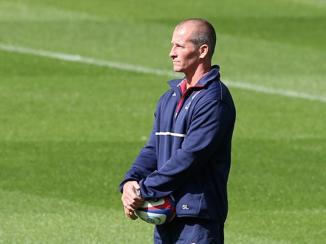 England head coach Stuart Lancaster watches on during a training session on September 4, 2015