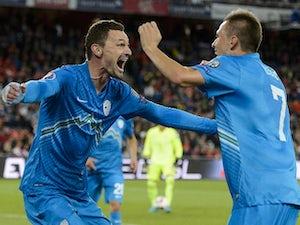 Slovenia battle past San Marino