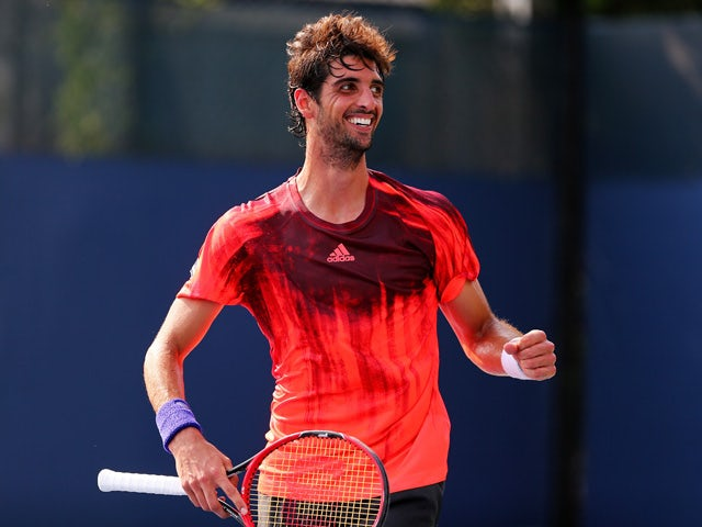 Thomaz Bellucci of Brazil reacts after defeating James Ward of Great Britain during his Men's Singles First Round match on Day Two of the 2015 US Open at the USTA Billie Jean King National Tennis Center on September 1, 2015