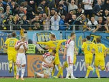 Ukrainian Andriy Yarmolenko (C) celebrates after scoring during the Euro 2016 qualifyinvg round - Group C football match between Ukraine and Belarus at Arena Lviv stadium in Lviv on September 5, 2015