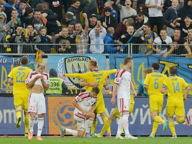 Ukrainian Andriy Yarmolenko (C) celebrates after scoring during the Euro 2016 qualifyinvg round - Group C football match between Ukraine and Belarus at Arena Lviv stadium in Lviv on September 5, 2015
