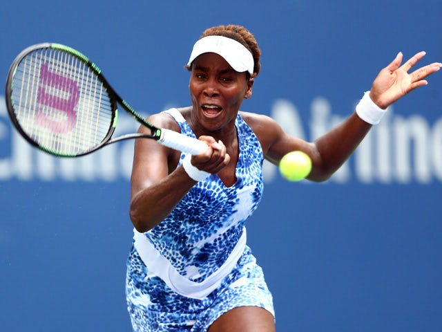 Venus Williams of the United States returns a shot against Monica Puig of Puerto Rico during her Women's Singles First Round match on Day One of the 2015 US Open at the USTA Billie Jean King National Tennis Center on August 31, 2015