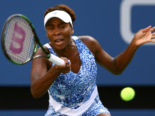 Venus Williams of the United States returns a shot against Anett Kontaveit of Estonia during their Women's Singles Fourth Round match on Day Seven of the 2015 US Open