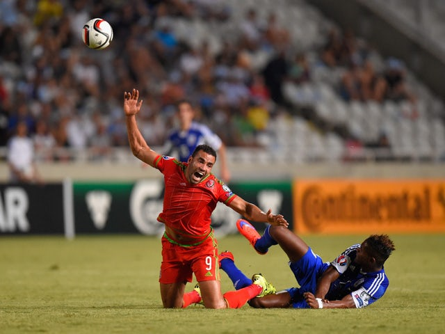 Wales player Hal Robson-Kanu is challenged by Dossa Junior of Cyprus during the UEFA EURO 2016 Qualifier between Cyprus and Wales at GPS Stadium on September 3, 2015