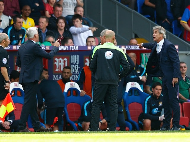 Silver-haired rivals Alan Pardew and Manuel Pellegrini get heated on the touchline as Crystal Palace host Man City on September 12, 2015