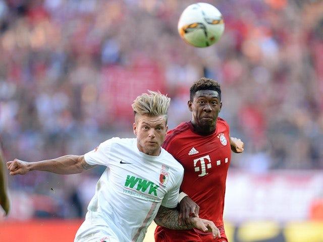 Augsburg's Alexander Esswein battles with David Alaba of Bayern Munich on September 12, 2015