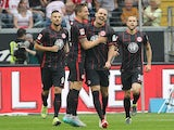 Alexander Meier celebrates with teammates after scoring for Eintracht Frankfurt against Koln on September 12, 2015