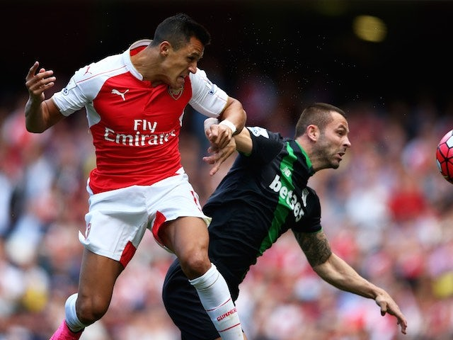 Alexis Sanchez and Phil Bardsley tussle during the game between Arsenal and Stoke on September 12, 2015