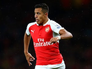 Alexis Sanchez of Arsenal in action during the Barclays Premier League match between Arsenal and Liverpool at the Emirates Stadium on August 24, 2015