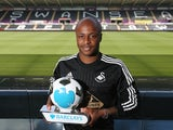 Andrew Ayew of Swansea City holds his Player of the Month award for August 2015